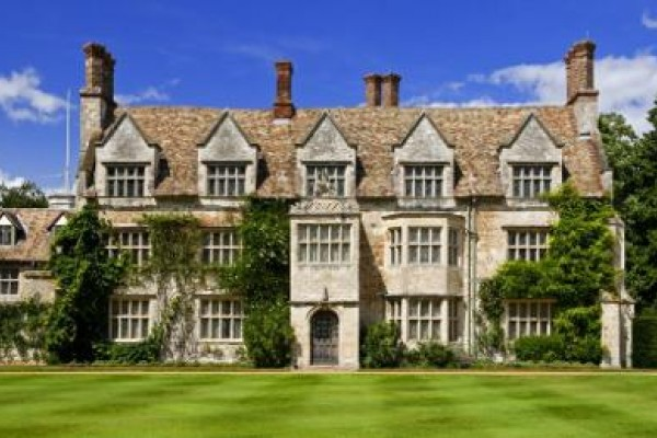 Anglesey Abbey built in grey stone looking beautiful on Summer's day