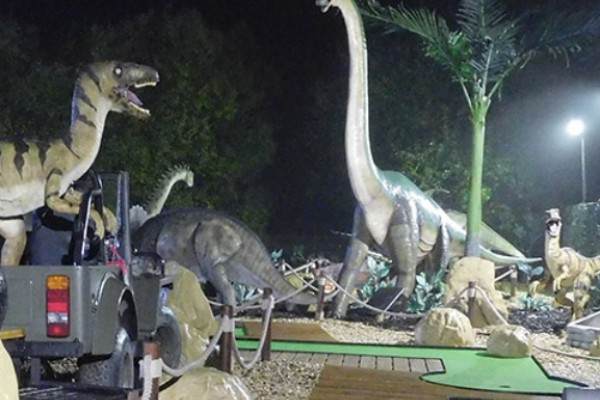 Image of Adventure Golf Berkshire surrounded by dinosaurs