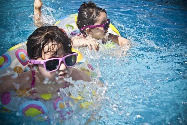 Kids enjoying their swim in the pool