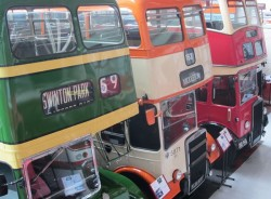 Places to visit Manchester - 3 vintage buses, green orange and red