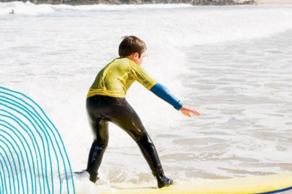 Kids Days Out in Cornwall - image of boy surfer riding the waves